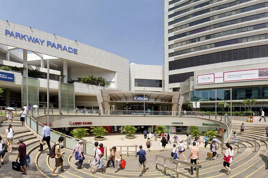 People walking about outside the Parkway Parade shopping centre in Marine Parade. -- PHOTO: LEND LEASE