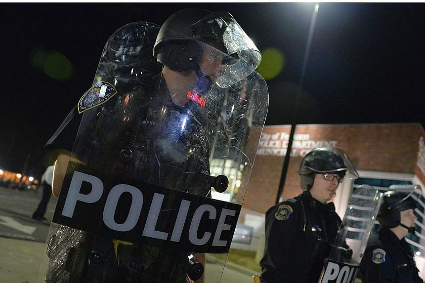 Ferguson police were sharply criticised for their heavy-handed actions in August during unrest triggered by the fatal shooting of an unarmed black teenager by a white officer. -- PHOTO: AFP