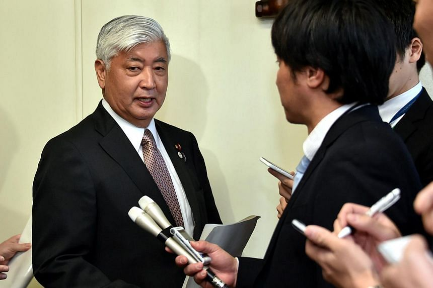 Japanese defence minister, Gen Nakatani (left), speaking to the press in Tokyo on March 30, 2015. -- PHOTO: AFP