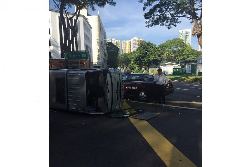 A taxi and a lorry collided at an Outram Road intersection on Thursday morning. -- PHOTO: REBECCA PAZOS