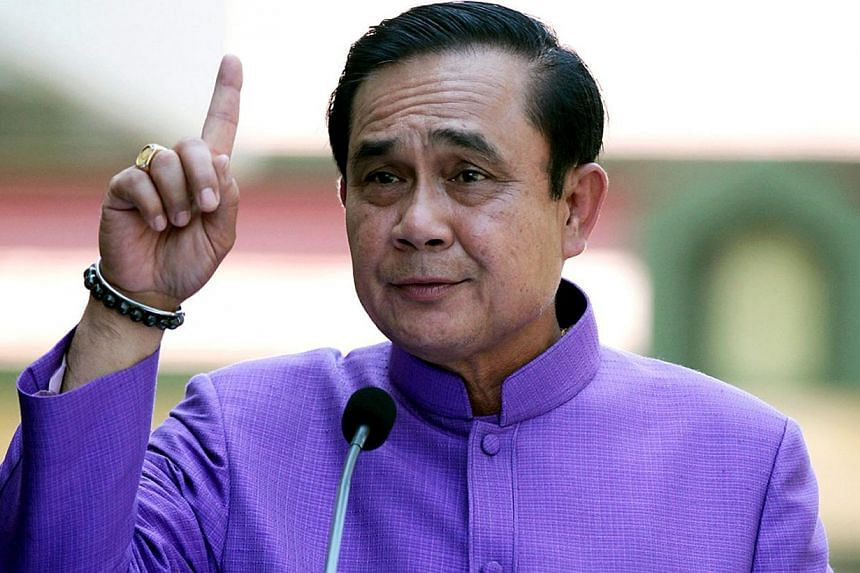 """Human Rights Watch warned that the use of """"unaccountable"""" power under Article 44 by Prime Minister General Prayut Chan-o-cha would mark Thailand's """"deepening descent into dictatorship"""". -- PHOTO: EPA"""