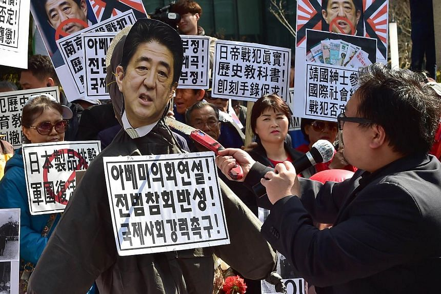 A South Korean protester hitting an effigy of Prime Minister Shinzo Abe during an anti-Japan rally outside the Japanese embassy in Seoul. Any careless remark in Mr Abe's World War II anniversary statement is bound to draw angry reactions from South K