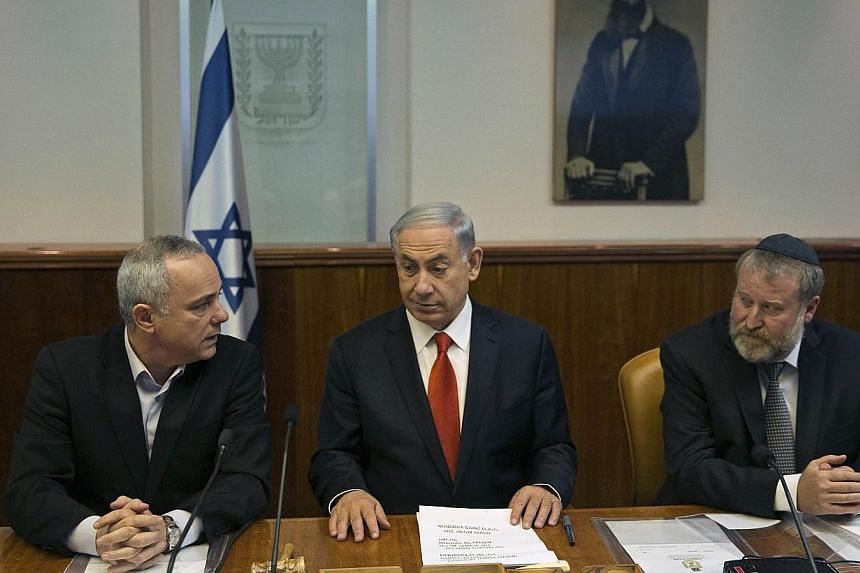 (From left) Israel's Strategic Affairs Minister Yuval Steinitz, Prime Minister Benjamin Netanyahu and Cabinet Secretary Avichai Mandelblit at a weekly cabinet meeting in Jerusalem onFeb 22, 2015. Steinitz said on Thursday, April 2, that all opt