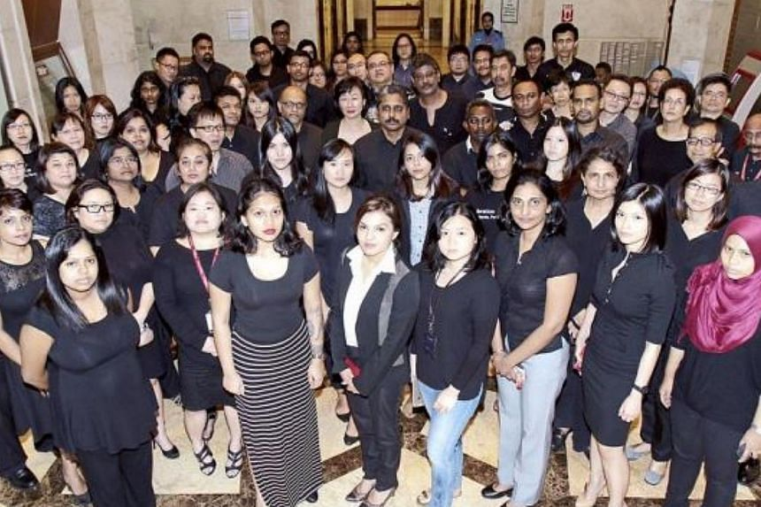 Journalists in media houses around Malaysia, including those from The Star (pictured), turned up for work in black, in a show of solidarity with online portal The Malaysian Insider (TMI) over the recent arrests of its editors and publisher. -- PHOTO: