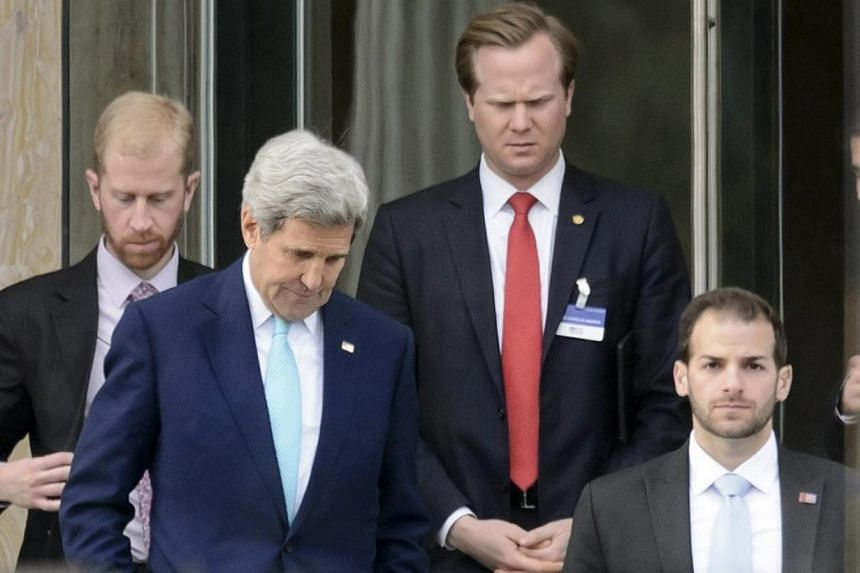 """US Secretary of State John Kerry (left) and German Foreign Minister Frank-Walter Steinmeier said they would stay at least until Thursday in an effort to seal the """"political"""" agreement, a milestone towards a final pact due by the end of June. -- PHOTO"""
