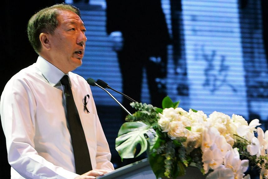 "Deputy Prime Minister Teo Chee Hean speaking at a tribute event at the Kallang Theatre on March 27, 2015. At the annual dinner of the Administrative Service, DPM Teo said former prime minister Lee Kuan Yew's ""commitment to clean government is legenda"