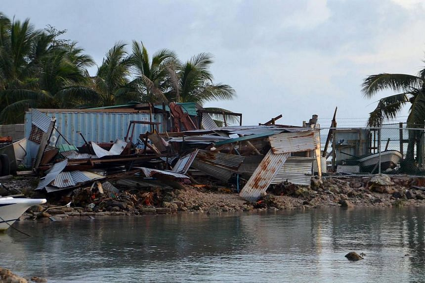 This picture taken on March 29, 2015, shows structures damaged during storms brought on by Super Typhoon Maysak near the village of Mwan, on the island of Weno, in the Micronesian state of Chuuk. -- PHOTO: AFP