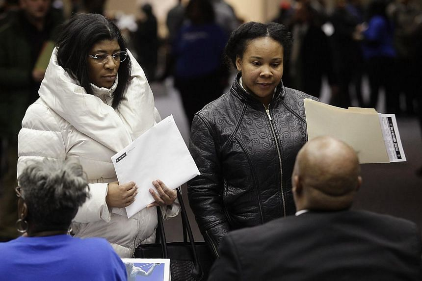 People attend a job fair in Detroit, Michigan, in this file photo taken on March 1, 2014. -- PHOTO: REUTERS
