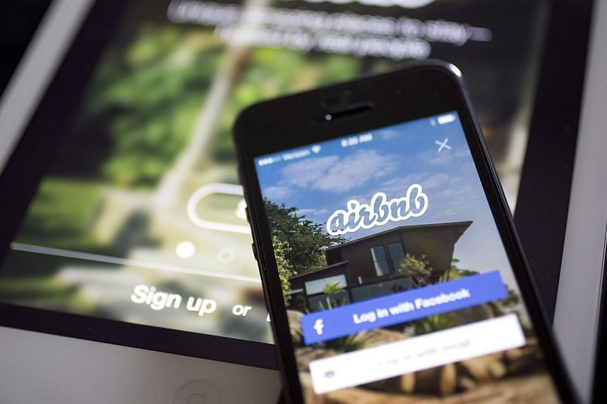 The Airbnb application is displayed on an Apple iPhone and iPad in this arranged photograph in Washington, DC, US, on March 21, 2014. The online lodging service Airbnb announced Thursday it was launching listings in Cuba for American visitors, i