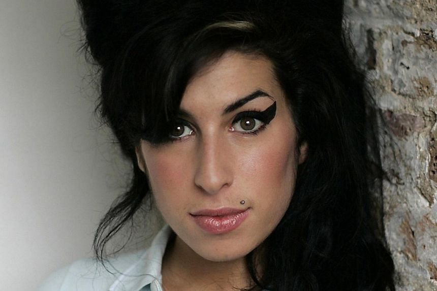 A new documentary on the life of late British singer Amy Winehouse (above) shows the six-time Grammy-Award winner in her younger days discussing her misgivings about fame, a preview of the trailer showed on Thursday. -- PHOTO: UNIVERSAL ISLAND