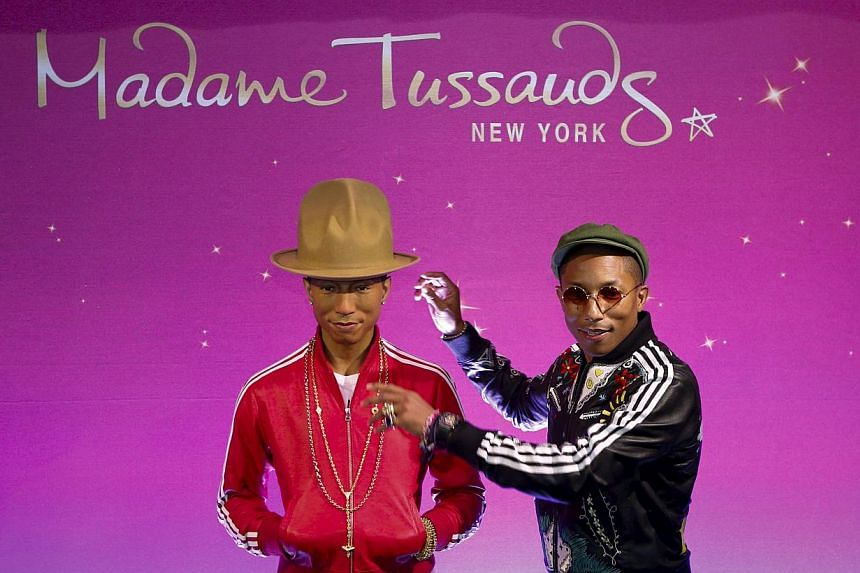 Musician Pharrell Williams poses next to his wax double at Madame Tussauds in New York April 1, 2015. -- PHOTO: REUTERS