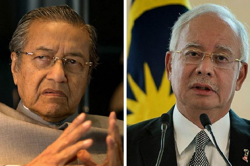"""Former Malaysian leader MahathirMohamad (left) launched a verbal broadside on beleaguered Prime Minister Najib Razak, saying among other things that the people in the country """"no longer trust"""" him. -- PHOTOS: AFP"""