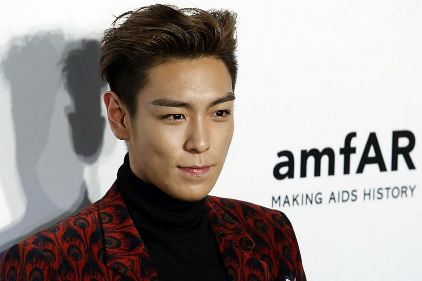 Korean pop sensation T.O.P of boy band Big Bang makes his international curatorial debut in Singapore after surprising art lovers with an unexpected appearance at this year's edition of the premier contemporary art fair Art Stage Singapore. -- PHOTO: