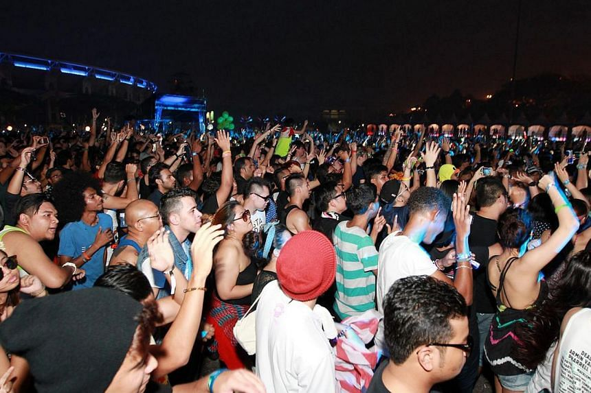 Concert-goers at the Bukit Jalil National Stadium in Kuala Lumpur, Malaysia for the Future Music Festival Asia 2014.The Future Music Festival, which was denied a licence to stage the show here this year, will be discontinued in Asia and Austral