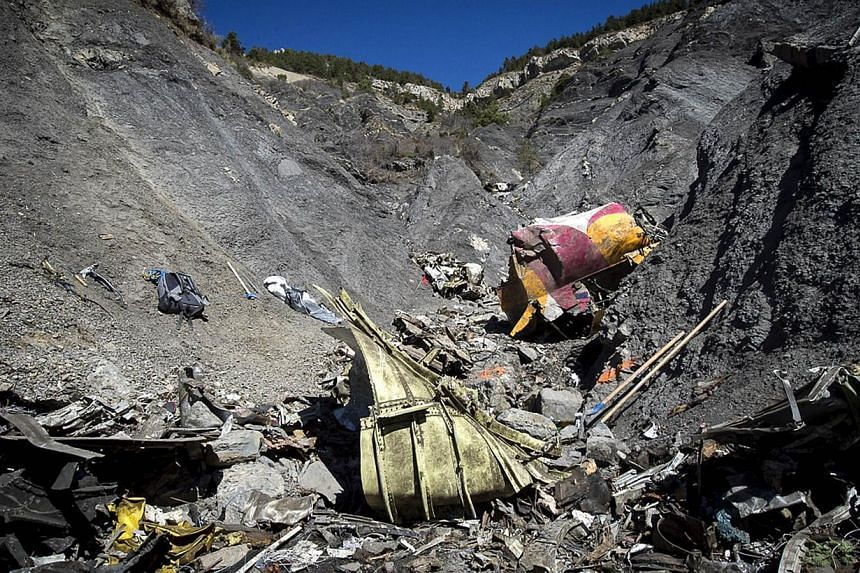 A part of the crash site of the Germanwings Airbus A320 near Le Vernet, French Alps. -- PHOTO: AFP/YVES MALENFER/DICOM/MINISTERE DE L'INTERIEUR