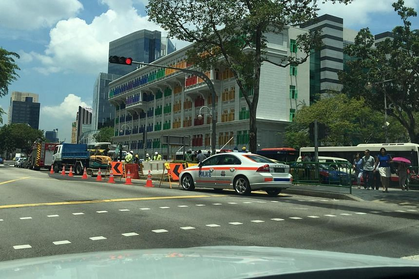 Police vehicles at the road worksite on Hill Street. -- PHOTO: IRENE HOE