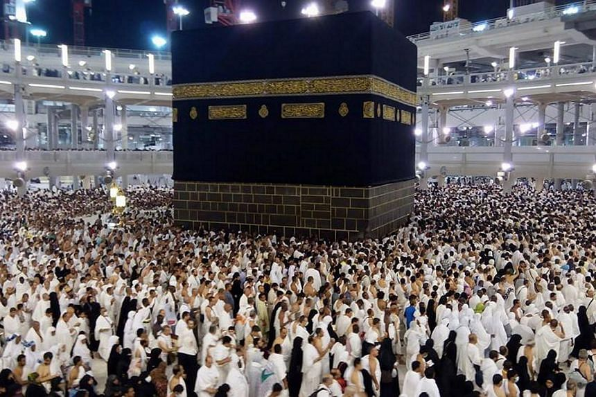 Muslim pilgrims performing the annual 'Haj' pilgrimage at the holy Kaaba in the Grand Mosque in Mecca, Saudi Arabia in 2014. The Muslim and Christian populations could be nearly equal by 2050, with Islam expected to be the fastest-growing faith