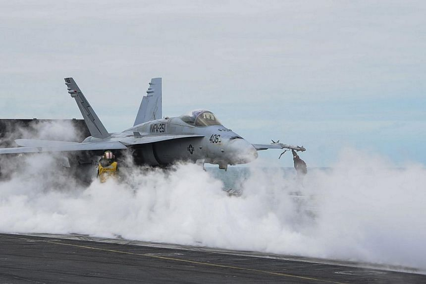 An F/A-18C Hornet prepares to launch from the flight deck of the USS Theodore Roosevelt (CVN 71) on March 22, 2015. China's Foreign Ministry expressed anger on Thursday after two US F-18 fighter jets landed in Taiwan, in a rare official contact