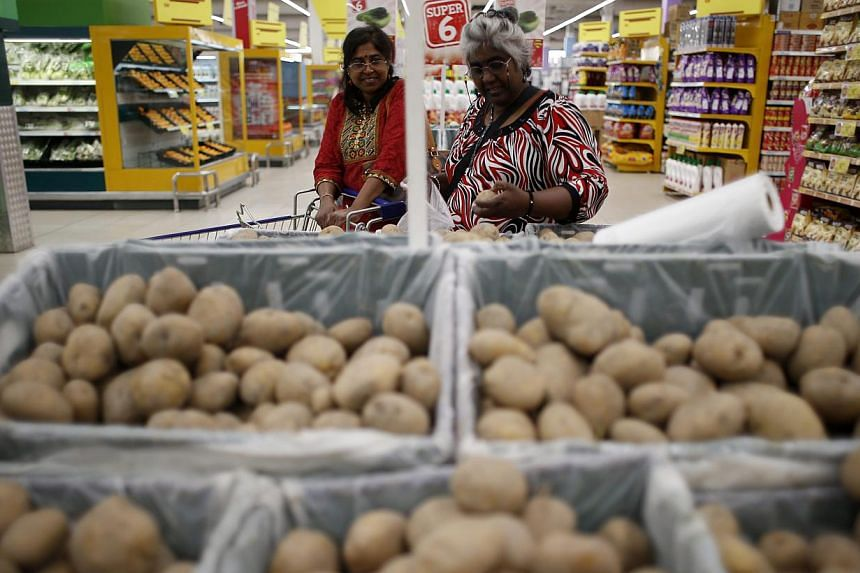 Two women shopping in a supermarket at Shah Alam, outside Kuala Lumpur, on April 1, 2015. Malaysia joined the ranks of 160 other countries globally in embracing the Goods and Services Tax (GST). Under the new GST, consumers will be charged a fl