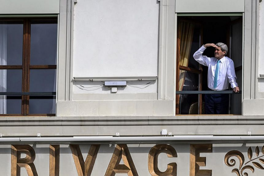 US Secretary of State John Kerry looks out of the window of his room at the Beau-Rivage Palace hotel during a break in Iran nuclear talks in Lausanne, Switzerland, on April 1, 2015. Kerry will stay in negotiations with Iran and his counterparts until
