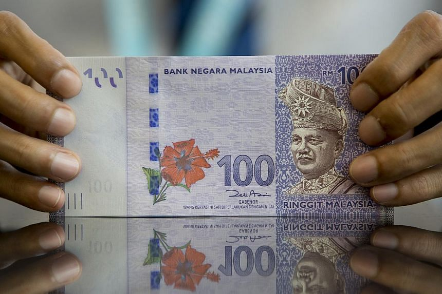 The Malaysian ringgit and the Indonesian rupiah both slumped to their lowest points versus the Singapore dollar since 1998 in January and December respectively, eroding how much gamblers from those countries can wager. -- PHOTO: BLOOMBERG