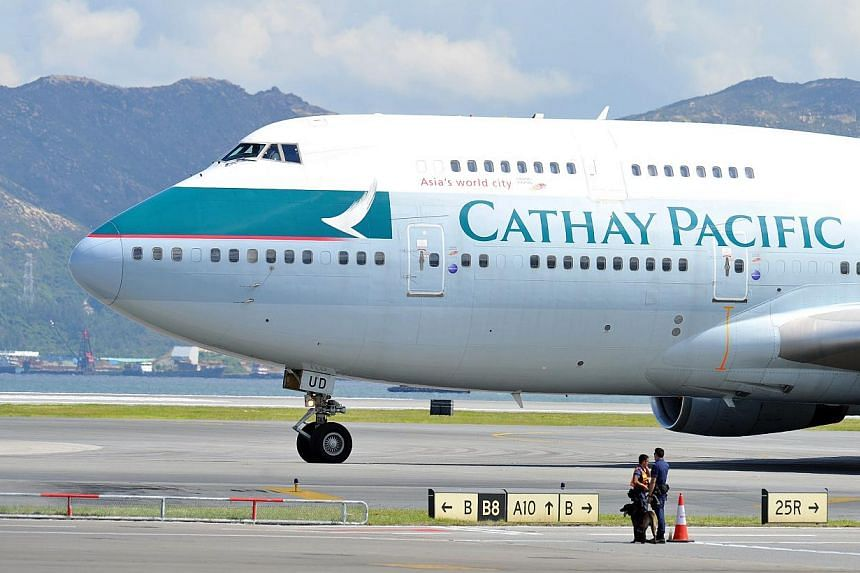 A Cathay Pacific Boeing 747 passenger plane taxis upon landing at Hong Kong's international airport on Aug 6, 2011. An artist has pleaded not guilty in a Hong Kong court over allegations of assaulting a flight attendant on a Cathay Pacific flight fro