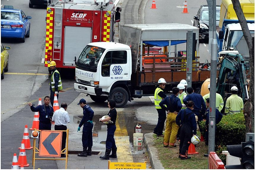 A fire broke out in a manhole at the junction of High Street and Hill Street on Thursday morning. -- PHOTO: SHIN MIN