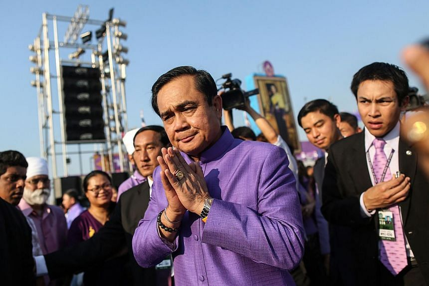 Thai junta chief and prime minister Prayuth Chan-ocha making a traditional greeting as he leaves after attending a birthday ceremony for Princess Maha Chakri Sirindhorn at Sanam Luang in Bangkok on April 2, 2015.-- PHOTO: AFP