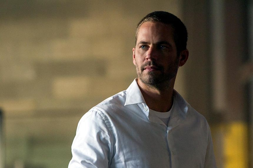 Paul Walker's death in November 2013 led to a temporary halt in production of Fast & Furious 7, the latest movie in the successful series about illegal street racing that helped popularise his career. -- PHOTO: UIP
