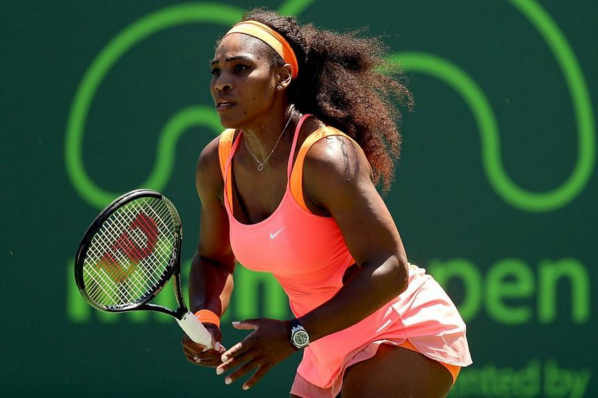 Serena Williams plays Sabine Lisiki of Germany at the Miami Open on April 1, 2015. Williams booked her semi-final berth at Miami on Wednesday with the 700th match win of her career.-- PHOTO: AFP