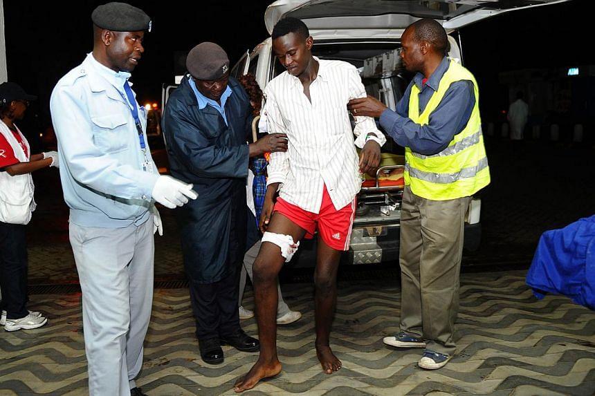 Paramedics attend to an injured Kenyan students as he arrives at Kenyatta National Hospital in Nairobi on April 2, 2015, following an attack at Garissa University College.At least 147 students were massacred when Somalia's Shebab Islami