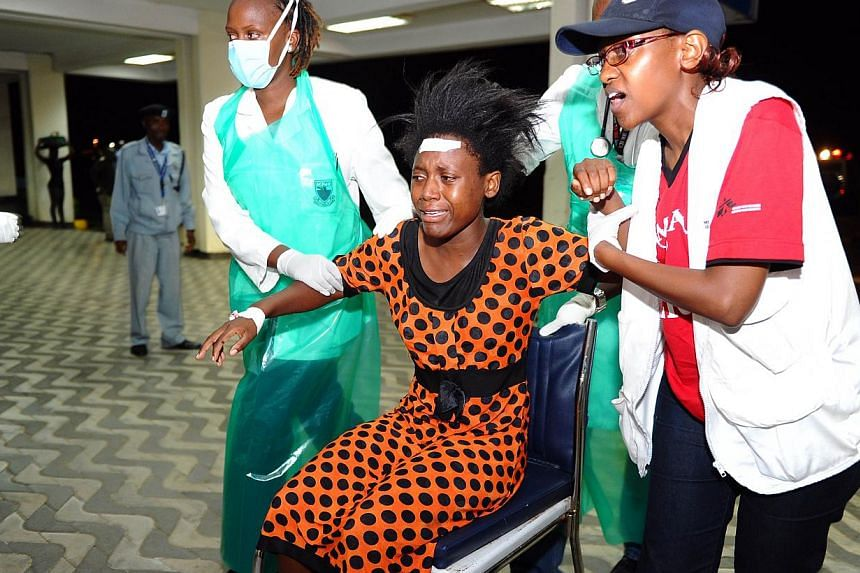 Paramedics attend to an injured Kenyan student as she is wheeled into Kenyatta National Hospital in Nairobi on April 2, 2015, following an attack at Garissa University College.At least 147 students were massacred when Somalia's Shebab Islamis