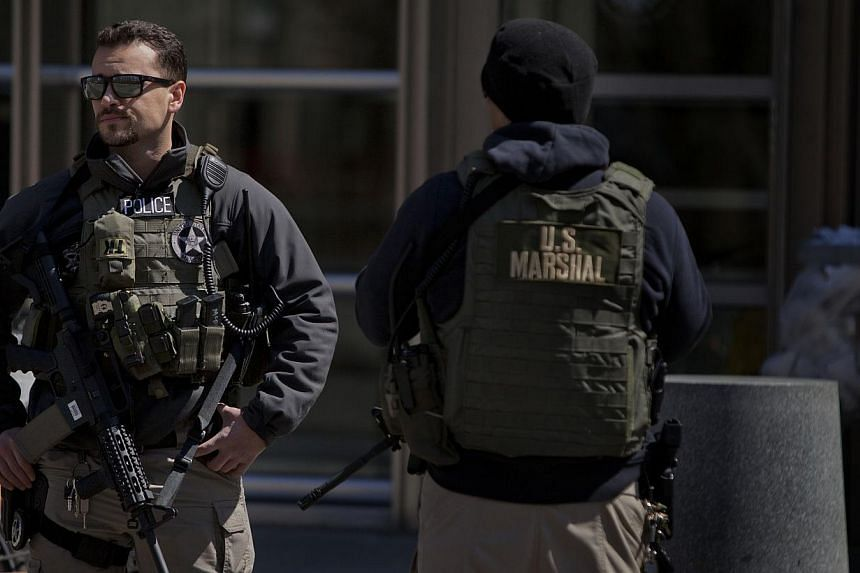 US Marshals stand outside the US Federal Court in Brooklyn during the arraignment on terrorism charges of two Queens women on April 2, 2015 in New York City. Two American women inspired by Al-Qaeda and extremists in Syria were arrested in New Yo