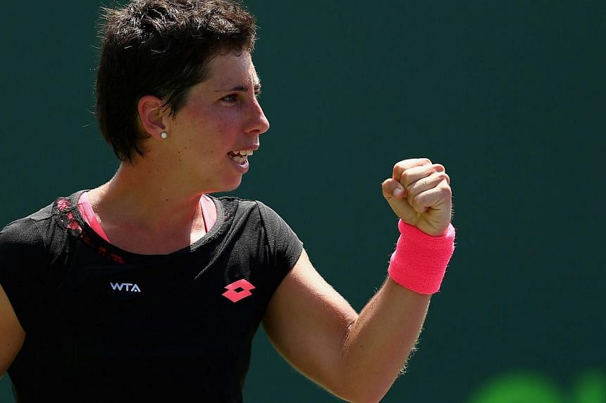 Carla Suarez Navarro (above) became the first Spanish woman in more than two decades to reach the final of the ATP and WTA Miami Masters with her 6-3, 6-3 defeat of Andrea Petkovic on Thursday. -- PHOTO: AFP
