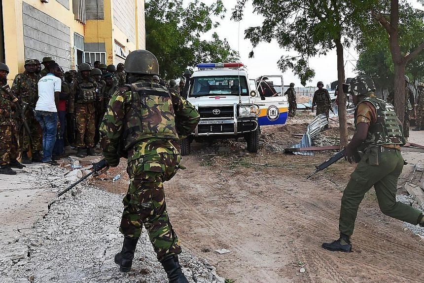 Kenyan Defence Forces run towards the Garissa University campus after an attack by Somalia's Al-Qaeda-linked Shebab gunmen in Garissa on April 2, 2015.At least 147 students were massacred when Somalia's Shebab Islamist group attacked a Kenyan