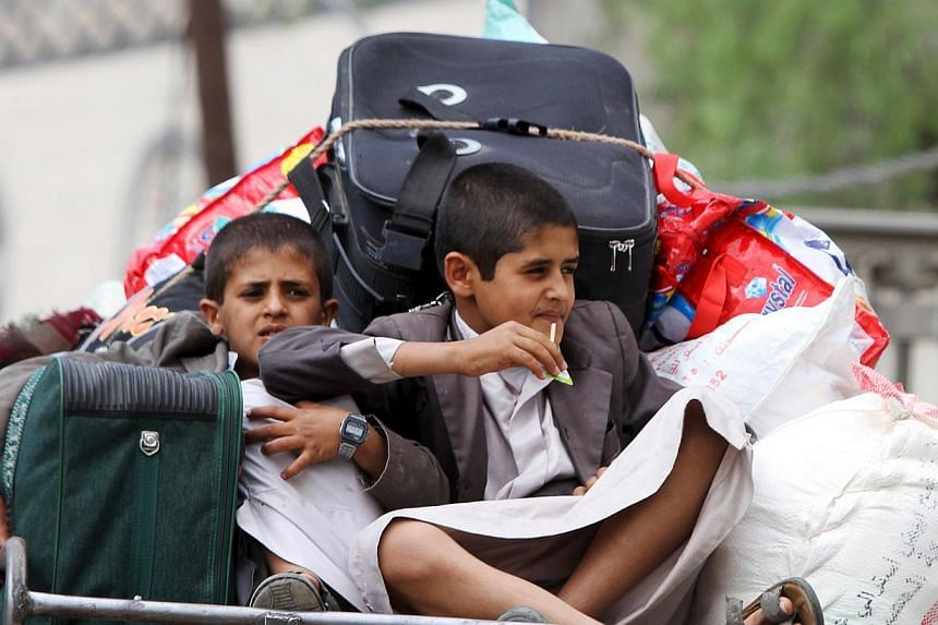 Boys fleeing Sanaa with their family and belongings, fearing renewed air strikes. The stage seems set for greater foreign military intervention.