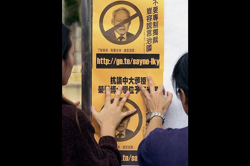 Students in Hong Kong putting up posters protesting against Mr Lee Kuan Yew's visit to the Chinese University of Hong Kong in December 2000 (right) to receive an honorary doctorate. Mr Lee was the first foreign political leader to receive such an hon