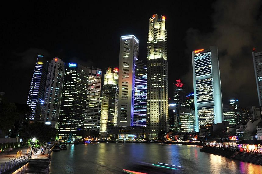 The Singapore skyline at night. The city is a far cry from the impoverished swampy island it was 50 years ago. -- PHOTO: ST FILE