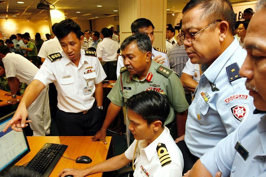 Military officers from Malaysia, Indonesia, Thailand and Singapore at the inaugural Malacca Strait Patrols Information System exercise held at Tuas Naval Base in March 2008. The system allows information about an incident to be passed on quickly to a