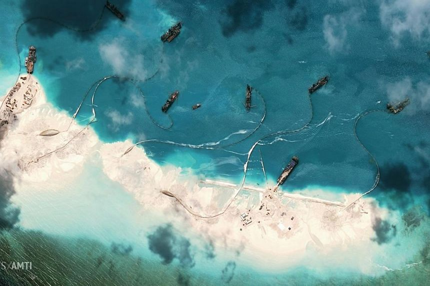 Dredgers deposit sand on the northern rim of the Mischief Reef, located 216km west of the Philippine island of Palawan, in this image provided by theCentre for Strategic and International Studies (CSIS) Asia Maritime Transparency Initiative on
