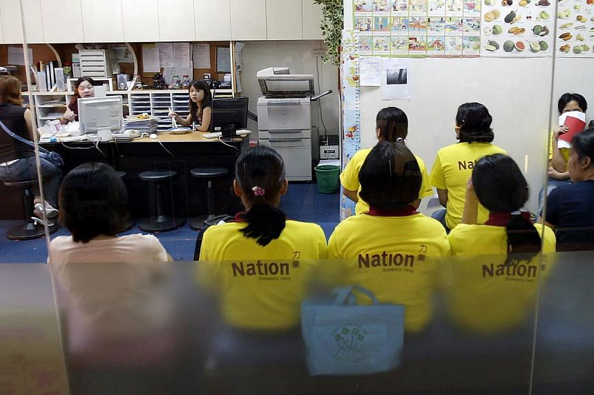 Maids at a maid agency in Hougang Green mall. -- PHOTO: ST FILE
