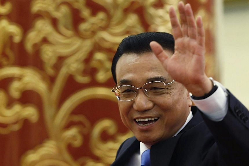 """Premier Li Keqiang says China is ready to continue to play its role in """"building the current international financial system"""", and also ready to work with other countries to """"help make the system more just, reasonable and balanced""""."""