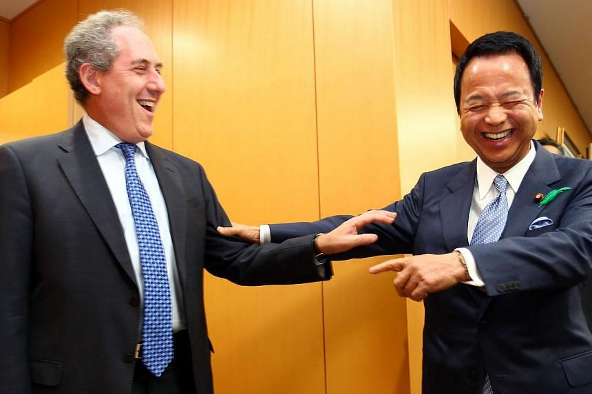 US Trade Representative Michael Froman (left) and Japan's Economy Minister Akira Amari exchanging greetings before talks over deadlocked TPP negotiations, which involve 12 countries.