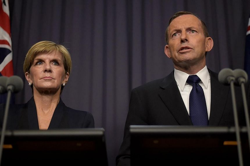 Australian Prime Minister Tony Abbott (right) and Australian Foreign Minister Julie Bishop speaking to the media at Parliament House in Canberra, Australia on April 29, 2015. -- PHOTO: EPA