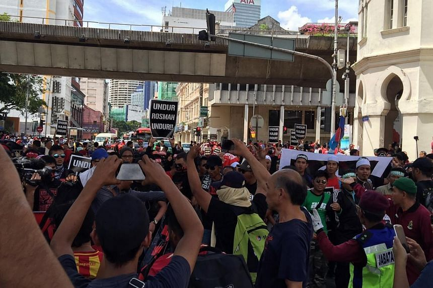 Hundreds of protesters gathering in Kuala Lumpur on Friday, May 1, 2015, for a rally against GST. -- ST PHOTO: ASRUL HADI ABDULLAH SANI