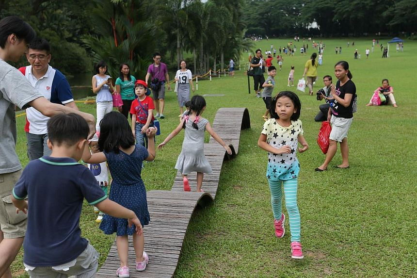 Fourteen benches from the former National Stadium have been recycled and permanently installed at the Istana's Swan Pond by the Urban Redevelopment Authority. -- ST PHOTO: ONG WEE JIN