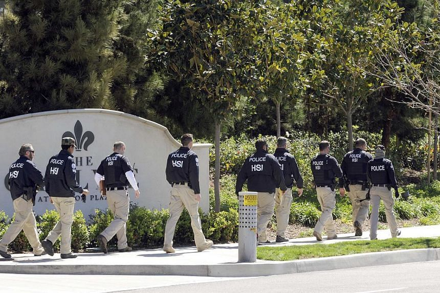 """Federal agents walking past a location of a suspected """"baby tourism"""" operation, in Irvine, California on March 3, 2015. -- PHOTO: REUTERS"""