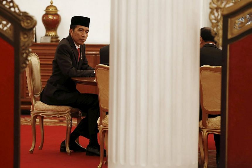 Indonesia's President Joko Widodo holding a meeting following a ceremony at the Presidential Palace in Jakarta, Indonesia on April 28, 2015. -- PHOTO: REUTERS
