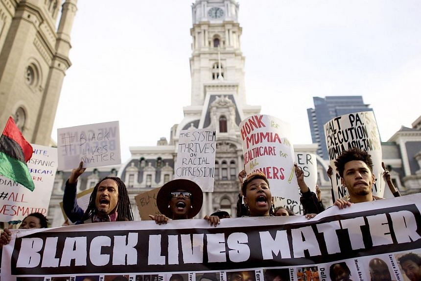 Protestors marching past City Hall during a demonstration over the death of Freddy Gray outside City Hall on April 30, 2015, in Philadelphia, Pennsylvania. -- PHOTO: AFP