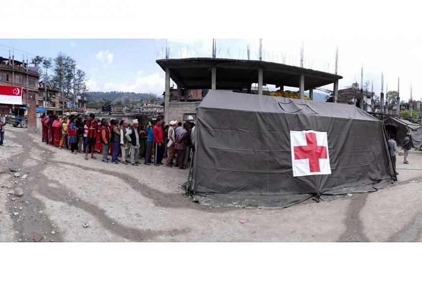 The SAF mobile clinic at the courtyard of a 1,500-year-old Hindu temple in Gokarna, a town on the outskirts of Kathmandu. It has been running since April 30, 2015. --ST PHOTO: LIM YAN LIANG